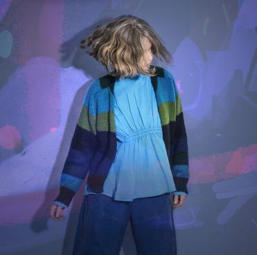 Juana Molina dancing in colored light
