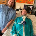 Photo of John The Reptilian with Jason Becker