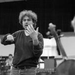Black and White photo of Carmine conducting a string section